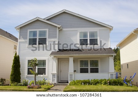 new beautiful American luxury houses at sunny day with green grass - stock photo