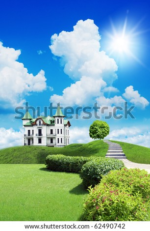 New beautiful house, summer cottage on a  grassland under sky with clouds - stock photo