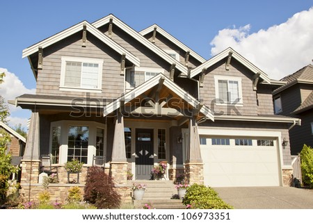new beautiful suburban house with blue sky and clouds