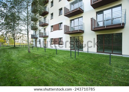 New big residential block with green yard - stock photo