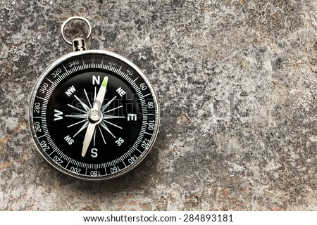 New black compass in closeup - stock photo