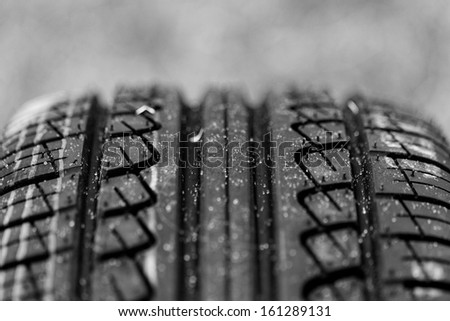 new black tire pattern with singns (car wheel) - stock photo