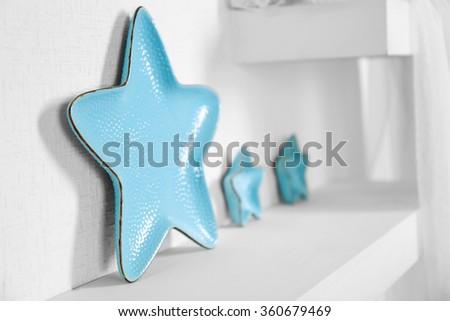 New blue dish on a shelf closeup - stock photo