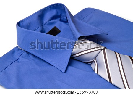 New blue man's shirt and tie isolated on white - stock photo