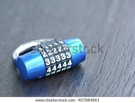 New blue metal combination lock on dark background. Combination lock. Lock. Blue lock. Code lock. Security lock. Metal lock. PIN lock. - stock photo