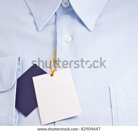 New blue shirt with blank label - stock photo
