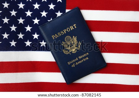 New Blue United States of America Passport isolated on US Flag background - stock photo