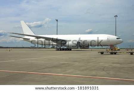 New Boeing 777 on Airport. hdr image with high dynamic range and compression . - stock photo