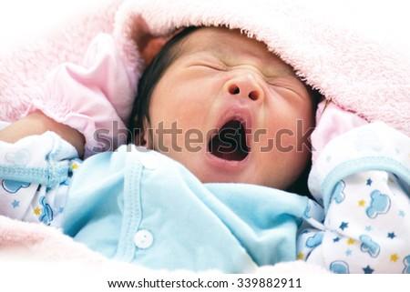new born baby be drowsy - stock photo
