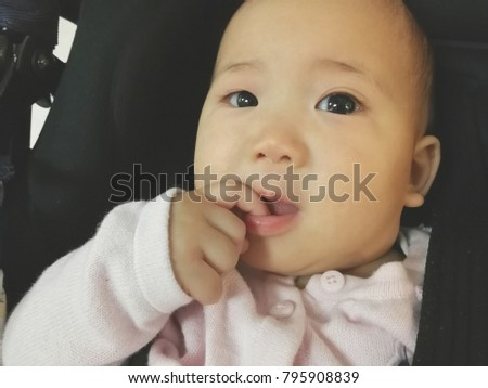 New born baby girl, charming asian kid.