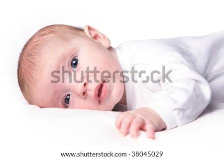 New born baby girl on white - stock photo