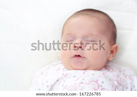 new born baby girl sleeping. Portrait