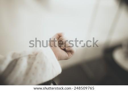 New born baby hand, vintage - stock photo