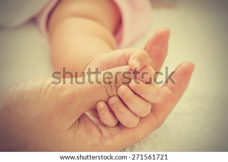 New born baby hand - vintage effect style pictures