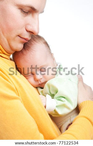 New born baby in father hands - stock photo
