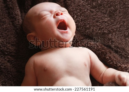 New born baby peacefully sleeping, - stock photo