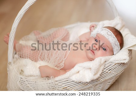 New born baby sleeping curled up on blanket, Newborn baby girl peacefully sleep, little baby slipping, cute 1 months baby lying down on blanket. soft selected focus, series - stock photo