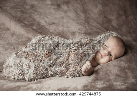 New Born Baby sleeping with brown cloth - stock photo