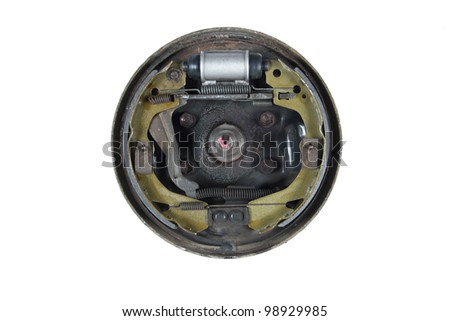 New brake pads and cylinder brake drum, isolated on a white background