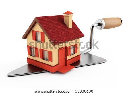 New brick house on construction trowel - stock photo