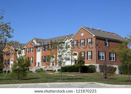 New brick townhouse complex - stock photo