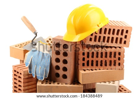 New bricks and building tools, isolated on white  - stock photo