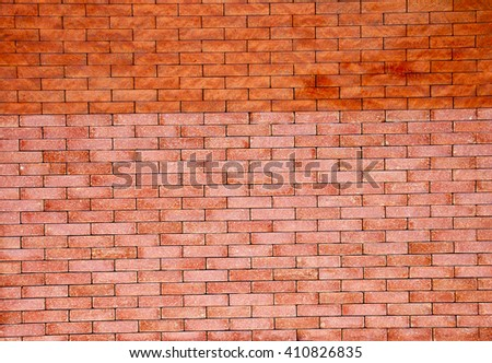 New brickwork of two types of bricks - stock photo