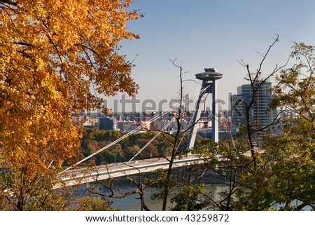 New Bridge over Danube River in Bratislava, Slovakia. Golden Fall Colors. - stock photo