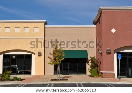 New Brown and Yellow Shopping Center Store Front - stock photo