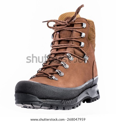 New brown leather hiking boot on white background - stock photo