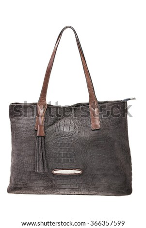New Brown leather womens bag with crocodile texture isolated on white background. - stock photo