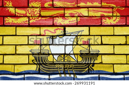 New Brunswick flag painted on old brick wall texture background - stock photo
