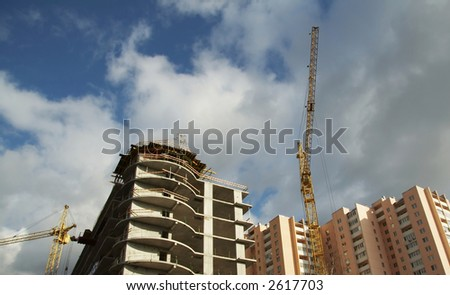 New building and crane on blue background