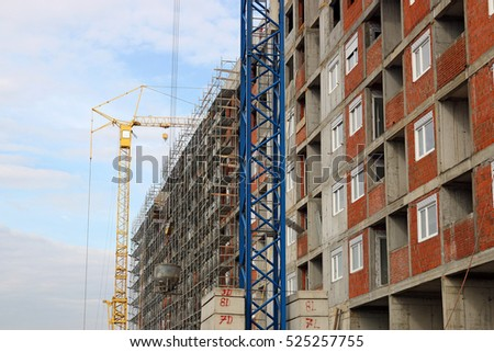 new building construction site with cranes