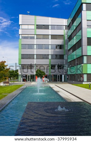 New building with fountain and pool foreground - stock photo
