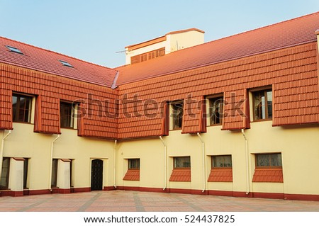 New building with red tiled roof