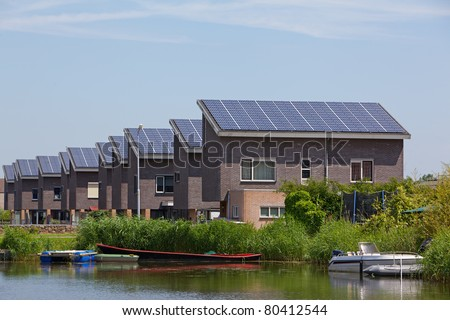 New building with solar panels - stock photo
