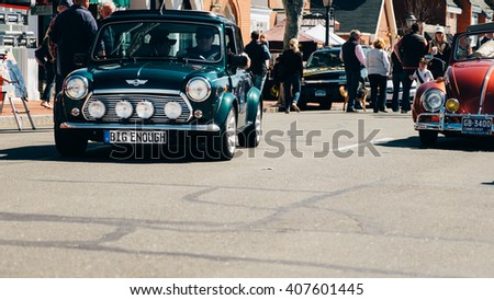 New Canaan,CT - April 17 2016: At a free public car show in New Canaan, a classic mini dealing a classic VW Bug. - stock photo