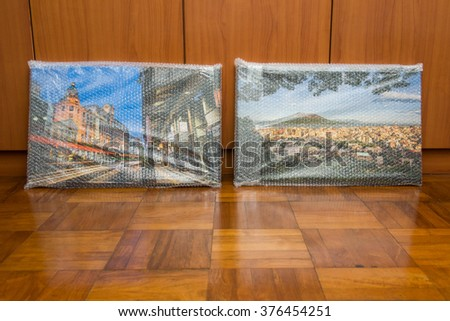 New canvas prints of landscape photos wrapped in protective bubble wrap. - stock photo