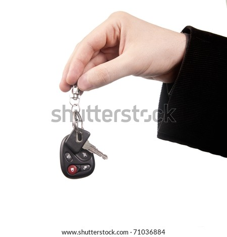 New car concept - hand and keys isolated on white - stock photo