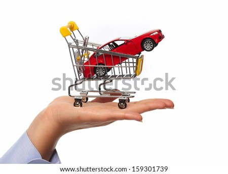 New car in shopping cart. Auto dealership concept background. - stock photo