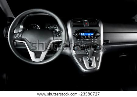 New Car Interior, Shiny and Black - stock photo