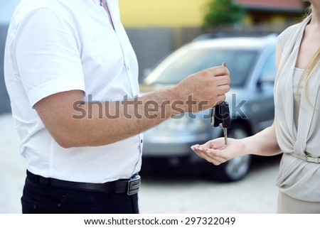 New car keys given to new car owner by salesman                             - stock photo