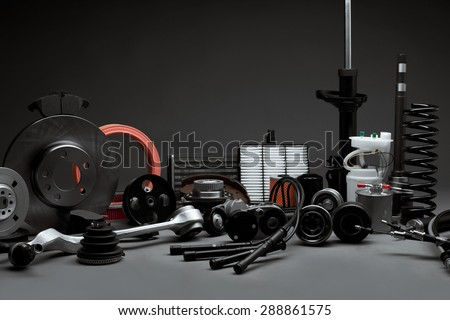 New car parts on a gray background closeup. Shop for auto - stock photo