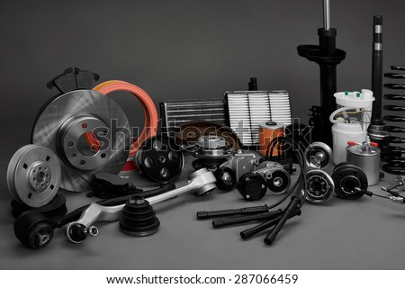New car wheels and filters on a gray background. Parts closeup on a gray background - stock photo