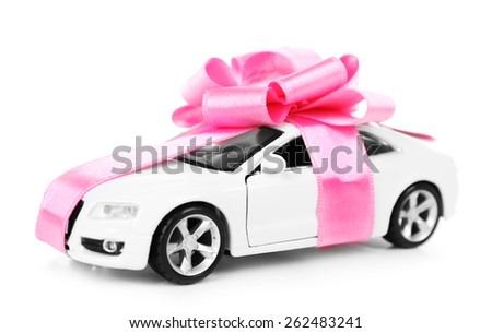 New car with pink bow as present isolated on white - stock photo