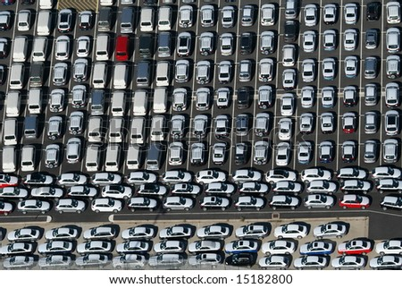 New cars waiting to be loaded and shipped. - stock photo
