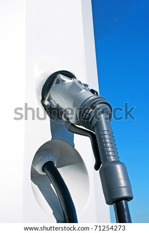 New charging hose in a station for electric car - stock photo