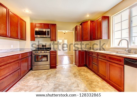 New cherry wood kitchen with stainless steal appliances.