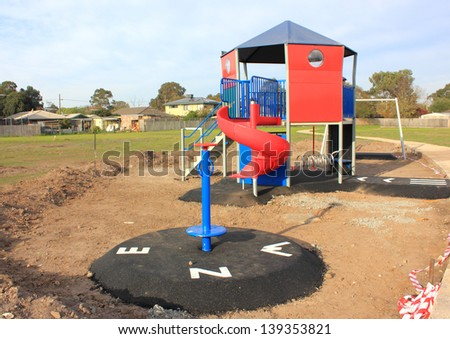 New childrens playground under construction in newly subdivided building estate in australia - stock photo